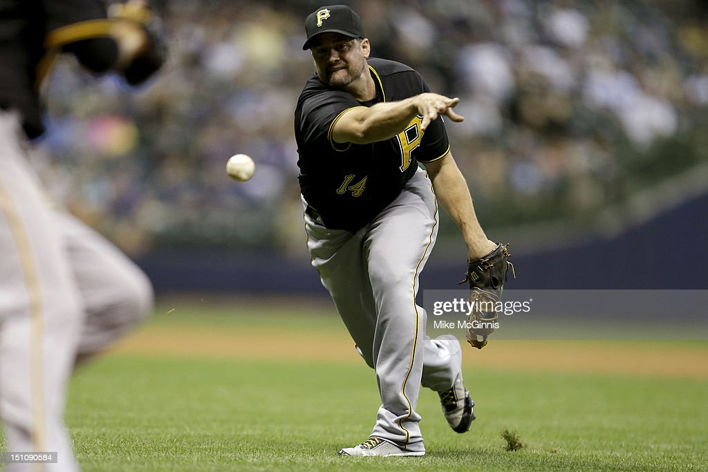 <a gi-track='captionPersonalityLinkClicked' href=/galleries/search?phrase=Gaby+Sanchez&family=editorial&specificpeople=4945789 ng-click='$event.stopPropagation()'>Gaby Sanchez</a> #14 of the Pittsburgh Pirates is late with the scoop and throw to first base, allowing Ryan Braun a single in the bottom of the eighth inning against the Milwaukee Brewers at Miller Park on August 31, 2012 in Milwaukee, Wisconsin.