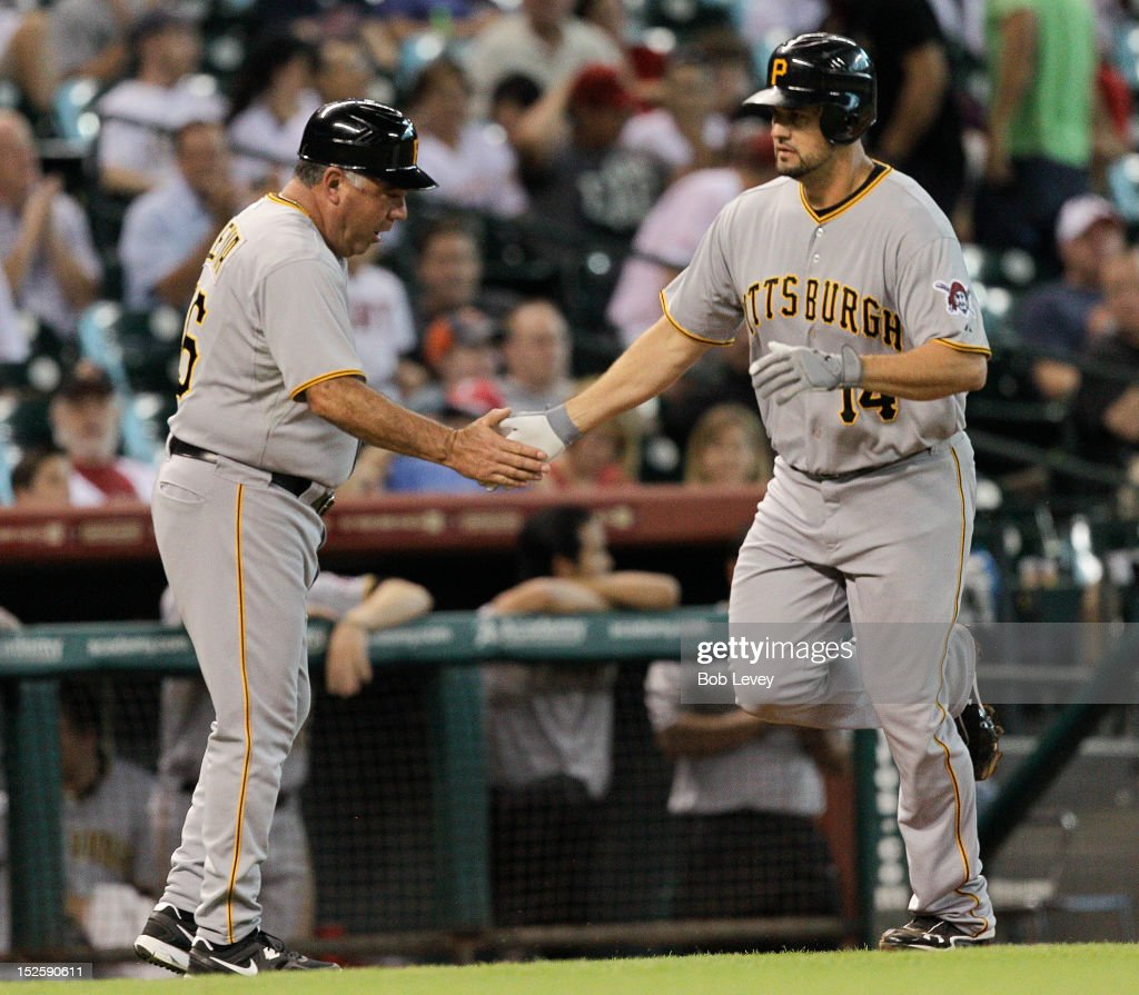 <a gi-track='captionPersonalityLinkClicked' href=/galleries/search?phrase=Gaby+Sanchez&family=editorial&specificpeople=4945789 ng-click='$event.stopPropagation()'>Gaby Sanchez</a> #14 of the Pittsburgh Pirates receives congratulations from third base coach Nick Leyva #16 after hitting a home run in the second inning against the Houston Astros at Minute Maid Park on September 22, 2012 in Houston, Texas.