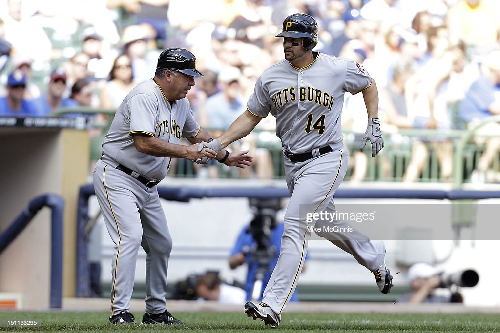 <a gi-track='captionPersonalityLinkClicked' href=/galleries/search?phrase=Gaby+Sanchez&family=editorial&specificpeople=4945789 ng-click='$event.stopPropagation()'>Gaby Sanchez</a> #14 of the Pittsburgh Pirates rounds the bases after hitting a two-run homer scoring Garrett Jones in the top of the 5th inning against the Milwaukee Brewers at Miller Park on September 02, 2012 in Milwaukee, Wisconsin.