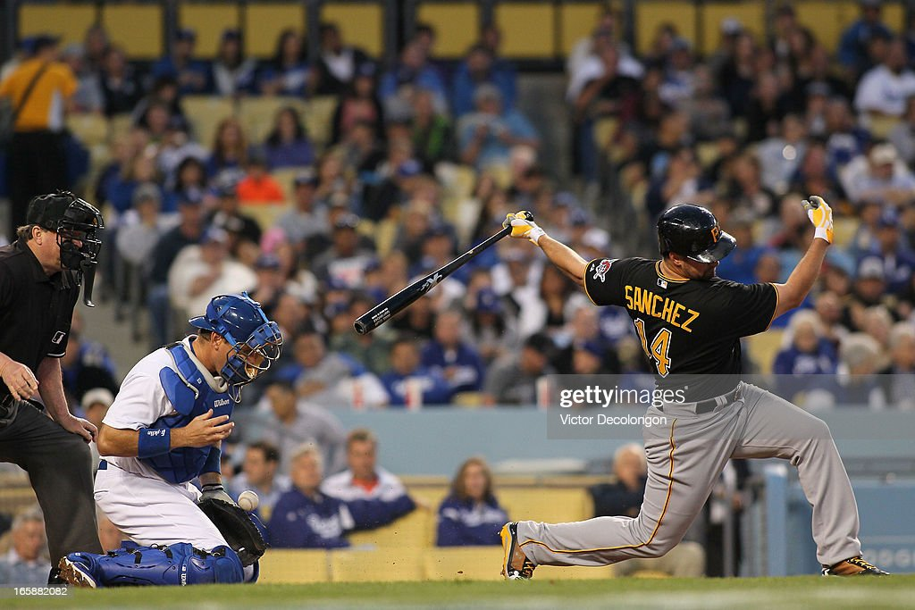 <a gi-track='captionPersonalityLinkClicked' href=/galleries/search?phrase=Gaby+Sanchez&family=editorial&specificpeople=4945789 ng-click='$event.stopPropagation()'>Gaby Sanchez</a> #14 of the Pittsburgh Pirates strikes out swinging to end the fourth inning as catcher A.J. Ellis #17 of the Los Angeles Dodgers tries to handle the pitch during the MLB game at Dodger Stadium on April 6, 2013 in Los Angeles, California.