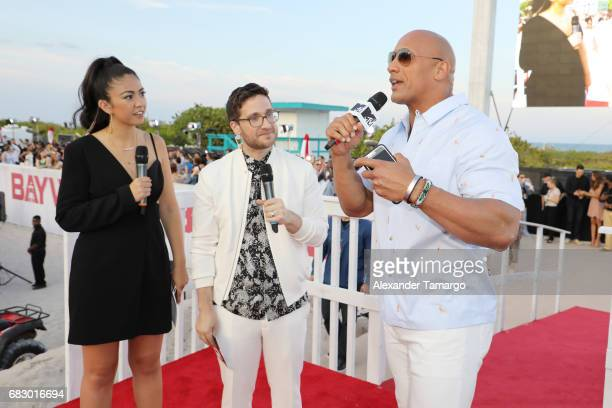 Gaby Wilson Josh Horowitz and Dwayne Johnson attend the world premiere of Paramount Pictures film 'Baywatch' at South Beach on May 13 2017 in Miami...
