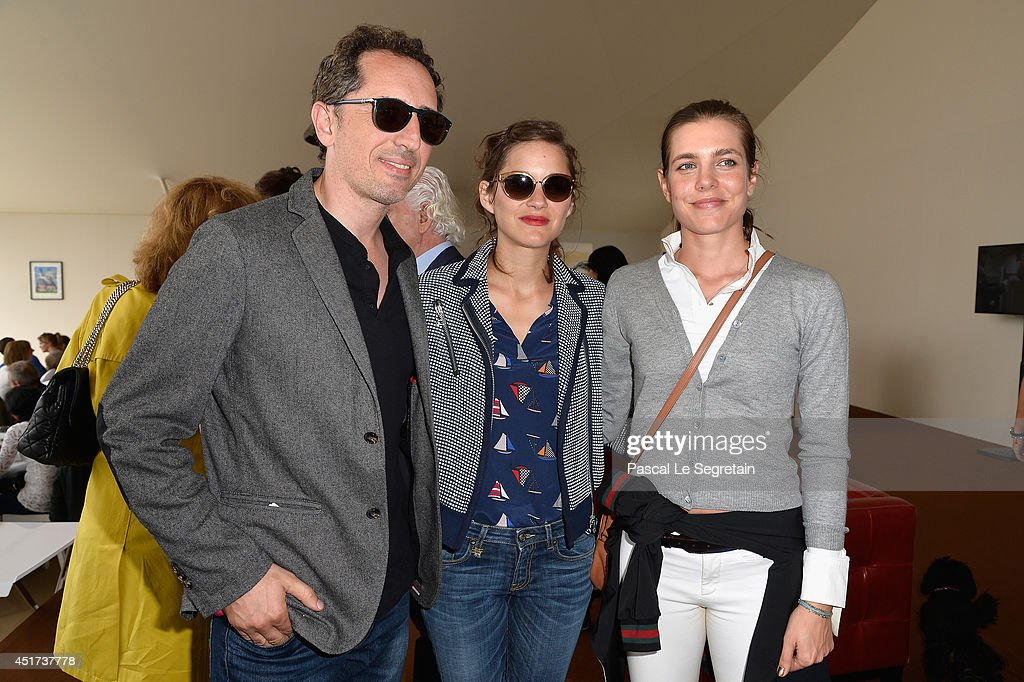 Gad Elmaleh, Marion Cotillard and Charlotte Casiraghi attend the Paris Eiffel Jumping presented by Gucci at Champ-de-Mars on July 5, 2014 in Paris, France.