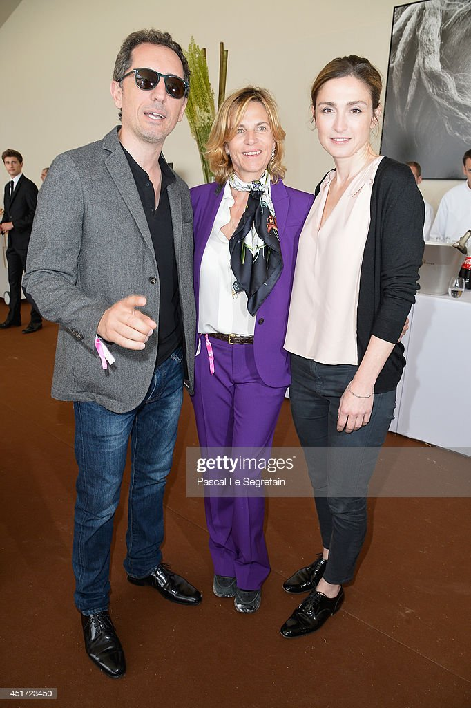 Gad Elmaleh, Virginie Couperie-Eiffel and Julie Gayet attend the Paris Eiffel Jumping presented by Gucci at Champ-de-Mars on July 5, 2014 in Paris, France.
