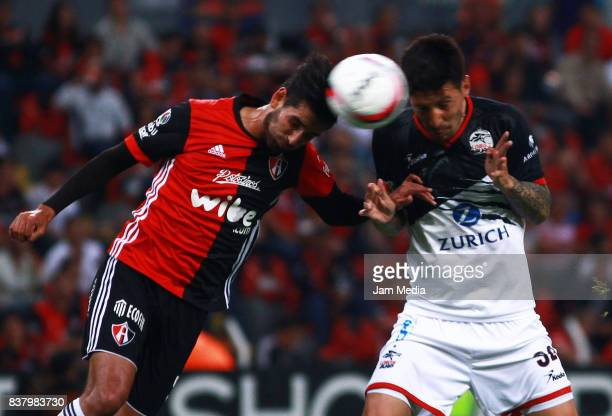 Gaddi Aguirre of Atlas and Jonathan Fabbro of Lobos BUAP jump for the ball during the 6th round match between Atlas and Lobos BUAP as part of the...