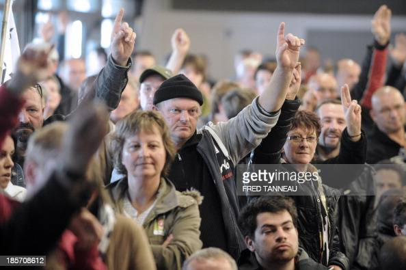 Gad's LampaulGuimiliau based slaughterhouse employees raise their hands in response to a unionist's question about their seniority in the company on...