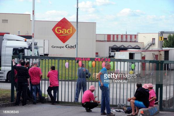 Gad's slaughterhouse workers block an entrance of the company in protest against the closure of the plant October 8 2013 in Josselin western of...