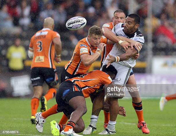 Gadwin Springer of Castleford Tigers tackles Manase Manuokafoa of Widnes Vikings during the First Utility Super League match between Castleford...