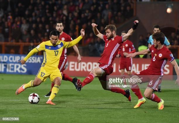 Gael Andonian Gor Malakyan and Henrikh Mkhitaryan of Armenia in action against Tanat Nuserbayev of Kazakhstan during the FIFA 2018 World Cup...
