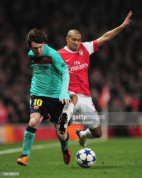 Gael Clichy of Arsenal challenges Lionel Messi of Barcelona during the UEFA Champions League round of 16 first leg match between Arsenal and...