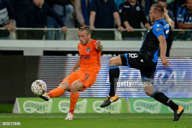 Gael Clichy of Istanbul Basaksehir is challenged by Laurens De Bock of Club Brugge during the Champions League Third Round Qualifier First Leg match...