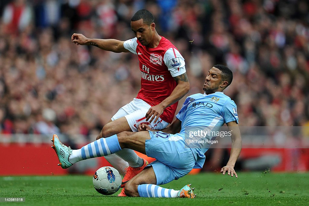 Gael Clichy of Man City tackles <a gi-track='captionPersonalityLinkClicked' href=/galleries/search?phrase=Theo+Walcott&family=editorial&specificpeople=451535 ng-click='$event.stopPropagation()'>Theo Walcott</a> of Arsenal during the Barclays Premier League match between Arsenal and Manchester City at Emirates Stadium on April 8, 2012 in London, England.