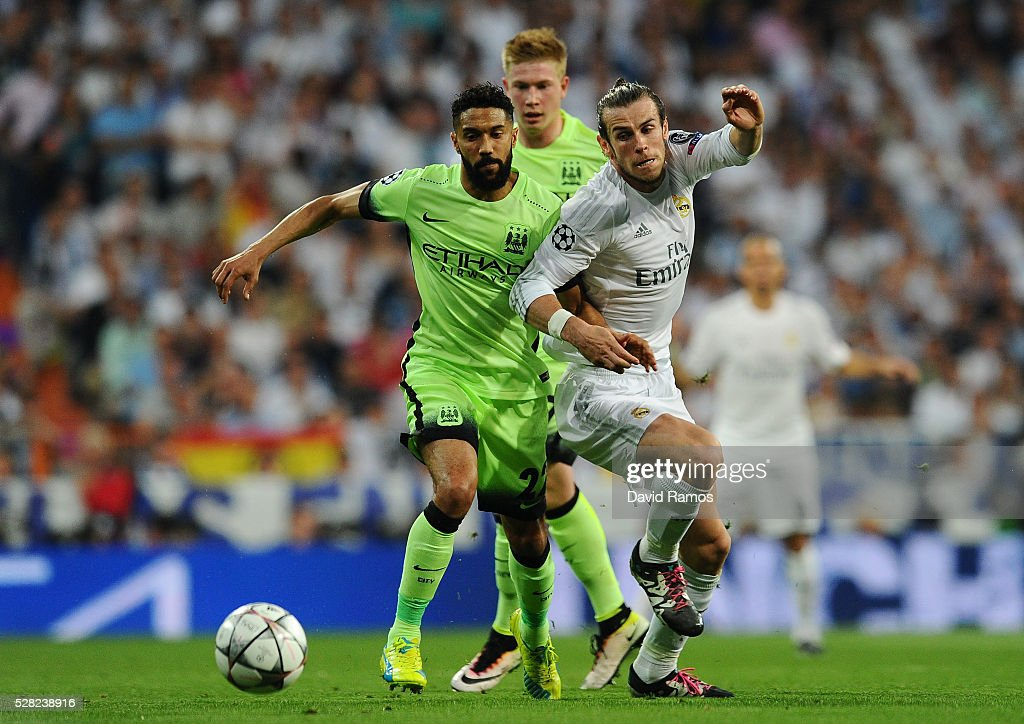 <a gi-track='captionPersonalityLinkClicked' href=/galleries/search?phrase=Gael+Clichy&family=editorial&specificpeople=214646 ng-click='$event.stopPropagation()'>Gael Clichy</a> of Manchester City and <a gi-track='captionPersonalityLinkClicked' href=/galleries/search?phrase=Gareth+Bale&family=editorial&specificpeople=609290 ng-click='$event.stopPropagation()'>Gareth Bale</a> of Real Madrid challenge for posession during the UEFA Champions League semi final, second leg match between Real Madrid and Manchester City FC at Estadio Santiago Bernabeu on May 4, 2016 in Madrid, Spain.