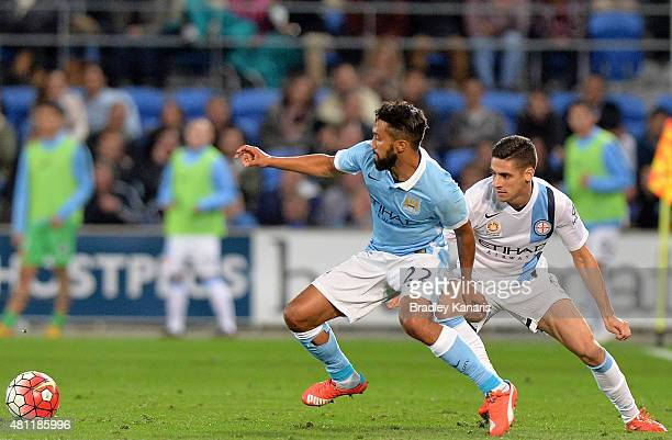 Gael Clichy of Manchester City and Nick Symoey of Melbourne compete for the ball during the international friendly match between Melbourne City and...