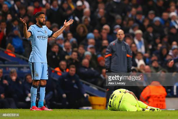 Gael Clichy of Manchester City appeals to the Referee after a challenge on Daniel Alves of Barcelona during the UEFA Champions League Round of 16...
