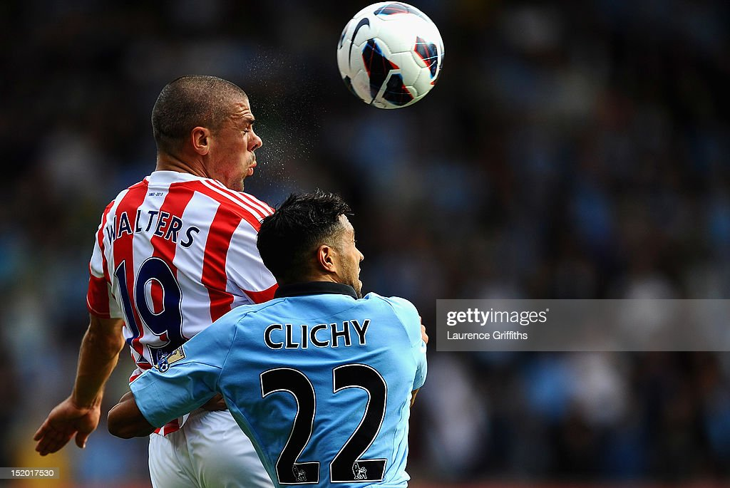 Gael Clichy of Manchester City battles with <a gi-track='captionPersonalityLinkClicked' href=/galleries/search?phrase=Jonathan+Walters&family=editorial&specificpeople=3389578 ng-click='$event.stopPropagation()'>Jonathan Walters</a> of Stoke City during the Barclays Premier League match between Stoke City and Manchester City at Britannia Stadium on September 15, 2012 in Stoke on Trent, England.
