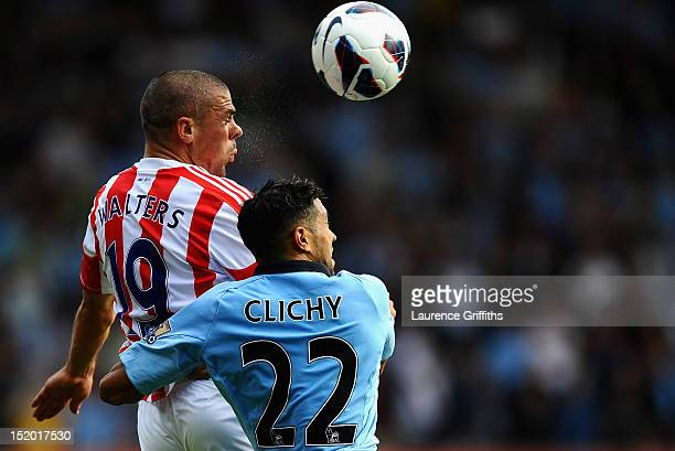 Gael Clichy of Manchester City battles with Jonathan Walters of Stoke City during the Barclays Premier League match between Stoke City and Manchester...