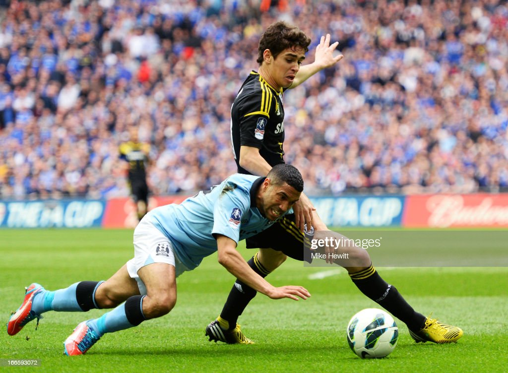 Gael Clichy of Manchester City battles with Oscar of Chelsea during the FA Cup with Budweiser Semi Final match between Chelsea and Manchester City at Wembley Stadium on April 14, 2013 in London, England.
