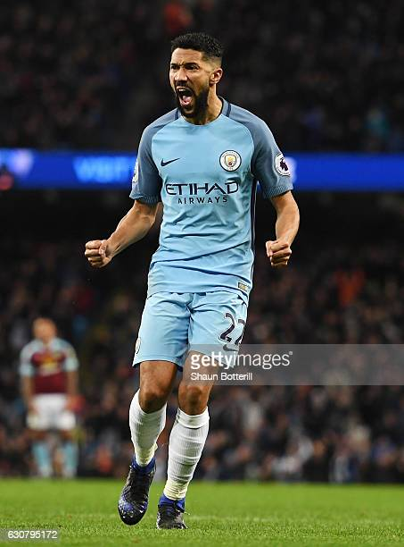 Gael Clichy of Manchester City celebrates scoring the opening goal during the Premier League match between Manchester City and Burnley at Etihad...