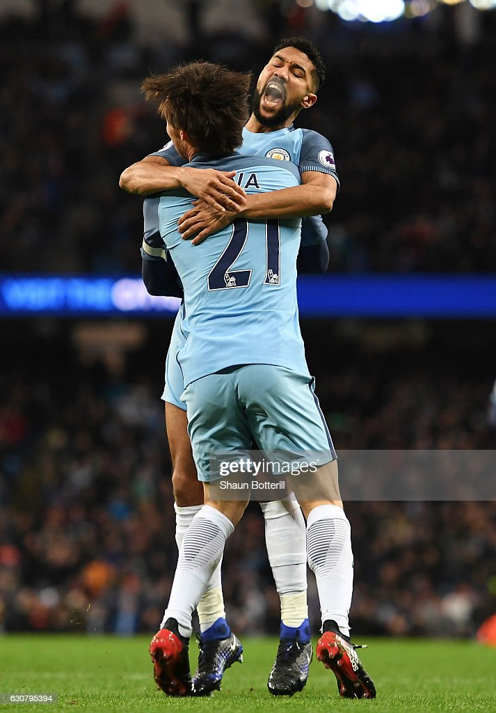 Gael Clichy of Manchester City celebrates scoring the opening goal with David Silva during the Premier League match between Manchester City and Burnley at Etihad Stadium on January 2, 2017 in Manchester, England.