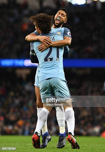 Gael Clichy of Manchester City celebrates scoring the opening goal with David Silva during the Premier League match between Manchester City and...