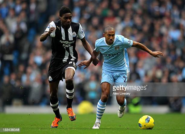 Gael Clichy of Manchester City competes with Sammy Ameobi of Newcastle United during the Barclays Premier League match between Manchester City and...