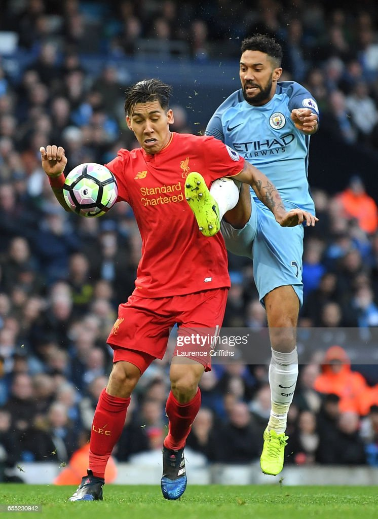 Gael Clichy of Manchester City (L) fouls Roberto Firmino of Liverpool (R) inside the box and a penalty is awarded to Liverpool during the Premier League match between Manchester City and Liverpool at Etihad Stadium on March 19, 2017 in Manchester, England.