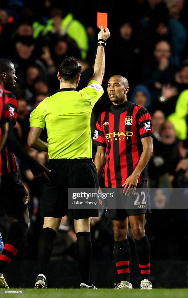 <a gi-track='captionPersonalityLinkClicked' href=/galleries/search?phrase=Gael+Clichy&family=editorial&specificpeople=214646 ng-click='$event.stopPropagation()'>Gael Clichy</a> of Manchester City is shown the red card by Referee <a gi-track='captionPersonalityLinkClicked' href=/galleries/search?phrase=Mark+Clattenburg&family=editorial&specificpeople=2108870 ng-click='$event.stopPropagation()'>Mark Clattenburg</a> during the Barclays Premier League match between Chelsea and Manchester City at Stamford Bridge on December 12, 2011 in London, England.