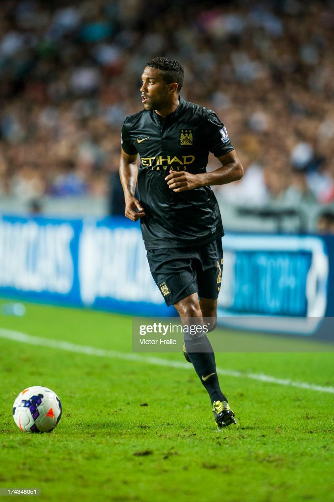 <a gi-track='captionPersonalityLinkClicked' href=/galleries/search?phrase=Gael+Clichy&family=editorial&specificpeople=214646 ng-click='$event.stopPropagation()'>Gael Clichy</a> of Manchester City runs with the ball during the Barclays Asia Trophy Semi Final match between Manchester City and South China at Hong Kong Stadium on July 24, 2013 in So Kon Po, Hong Kong.