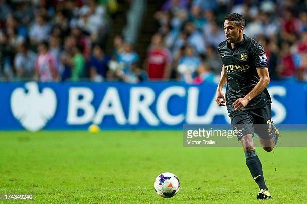 Gael Clichy of Manchester City runs with the ball during the Barclays Asia Trophy Semi Final match between Manchester City and South China at Hong...