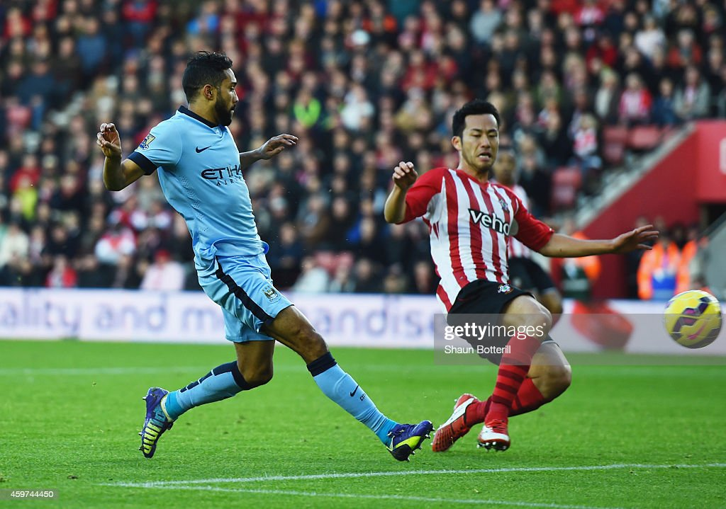 Gael Clichy of Manchester City shoots past <a gi-track='captionPersonalityLinkClicked' href=/galleries/search?phrase=Maya+Yoshida&family=editorial&specificpeople=5398323 ng-click='$event.stopPropagation()'>Maya Yoshida</a> of Southampton to score their third goal during the Barclays Premier League match between Southampton and Manchester City at St Mary's Stadium on November 30, 2014 in Southampton, England.