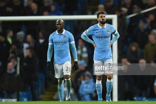 Gael Clichy of Manchester City shows dejection after conceding the first goal to Swansea during the Barclays Premier League match between Manchester...