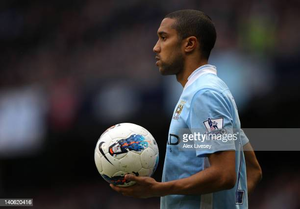 Gael Clichy of Manchester City waits to take a throw in during the Barclays Premier League match between Manchester City and Bolton Wanderers at the...