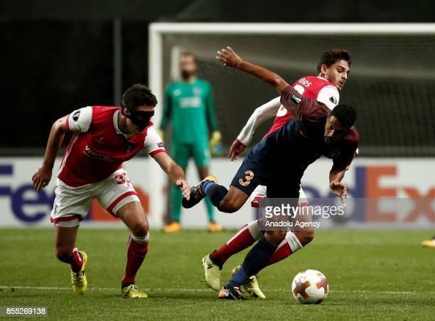 Gael Clichy of Medipol Basaksehir in action against Nikola Vukcevic of Sporting Braga during the UEFA Europa League Group C match between Sporting...