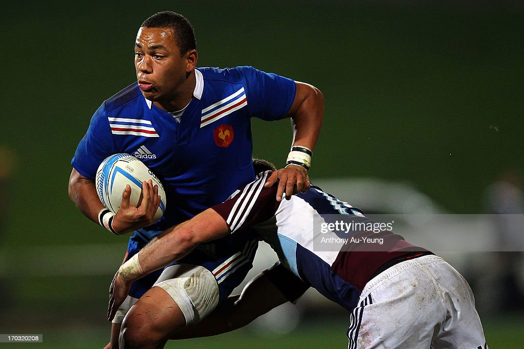 Gael Fickou of France is tackled by Marty McKenzie of the Blues during the tour match between the Auckland Blues and France at North Harbour Stadium on June 11, 2013 in Auckland, New Zealand.