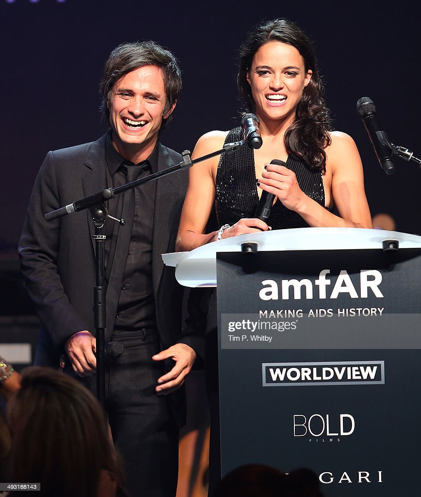 Gael Garcia Bernal and Michelle Rodriguez speak onstage during amfAR's 21st Cinema Against AIDS Gala Presented By WORLDVIEW BOLD FILMS And BVLGARI at...