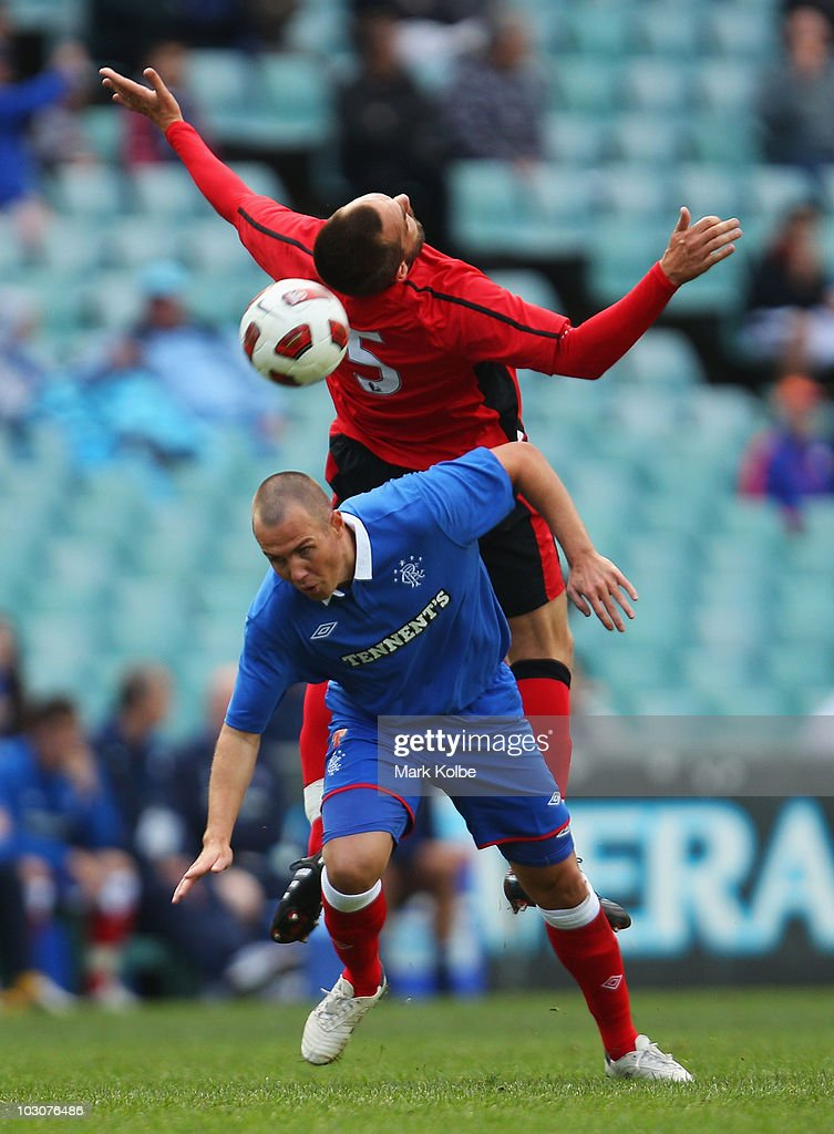 Gael Givet of the Rovers and Jason Roberts of Rangers complete for the ball during the pre-season friendly match between Blackburn Rovers and Glasgow Rangers at the Sydney Football Stadium on July 25, 2010 in Sydney, Australia.