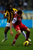 Gael Kakuta of Vitesse and Dirk Marcellis of AZ battle for the ball during the Eredivisie match between Vitesse Arnhem and AZ Alkmaar at Gelredome on...