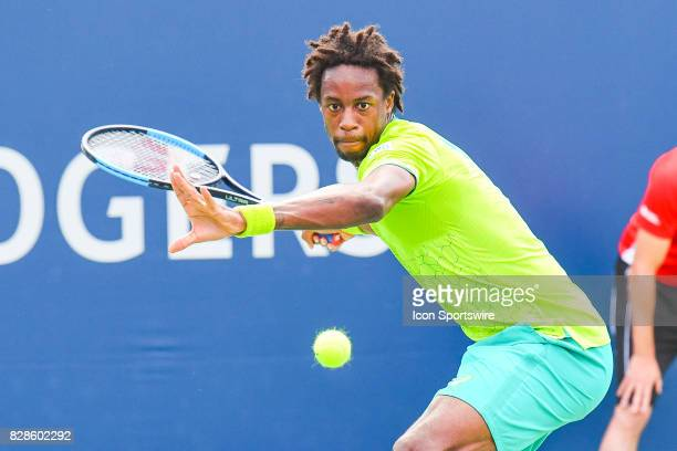 Gael Monfils keeps eye contact with the ball then returns it during his second round match at ATP Coupe Rogers on August 9 at Uniprix Stadium in...