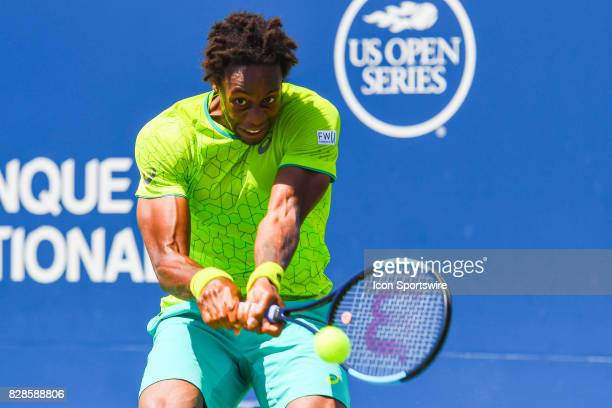 Gael Monfils makes eye contact and returns the ball during his second round match at ATP Coupe Rogers on August 9 at Uniprix Stadium in Montreal QC