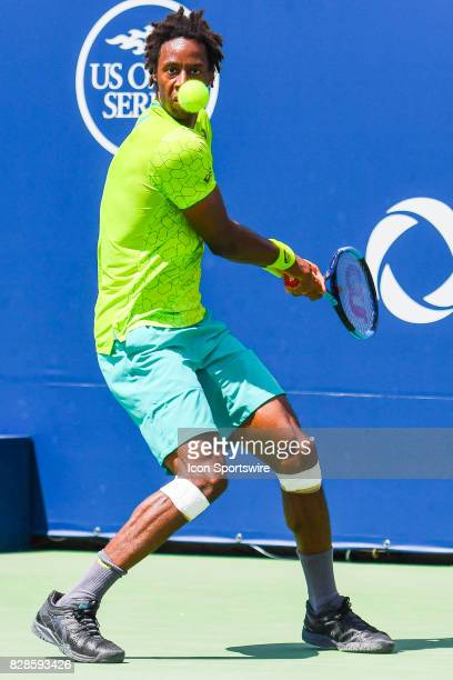 Gael Monfils makes eye contact with the ball then returns it during his second round match at ATP Coupe Rogers on August 9 at Uniprix Stadium in...