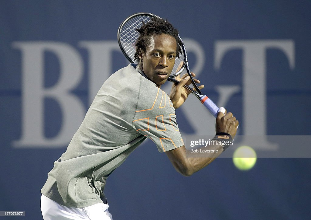 <a gi-track='captionPersonalityLinkClicked' href=/galleries/search?phrase=Gael+Monfils&family=editorial&specificpeople=213774 ng-click='$event.stopPropagation()'>Gael Monfils</a> of France aims his backhand return against Guido Pella of Argentina on August 20, 2013 in Winston Salem, North Carolina.