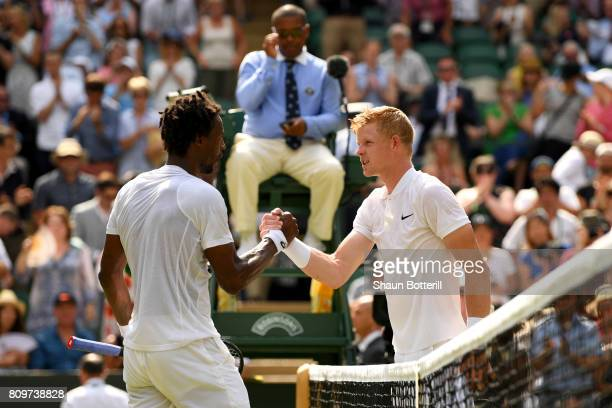 Gael Monfils of France and Kyle Edmund of Great Britain shake hands after their Gentlemen's Singles second round match on day four of the Wimbledon...