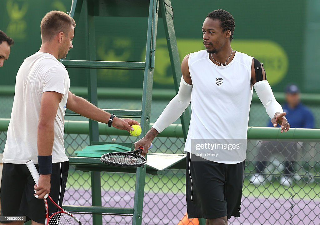 Gael Monfils of France at practice with Michal Przysiezny of Poland during Day One of the Qatar Open 2013, first tournament of the ATP World Tour 2013, held at the Khalifa International Tennis and Squash Complex on December 31, 2012 in Doha, Qatar.