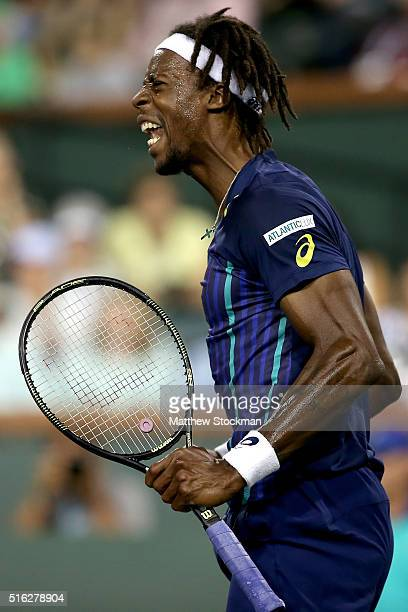Gael Monfils of France celebrates a point against Milos Raonic of Canada during the BNP Paribas Open at the Indian Wells Tennis Garden on March 17...