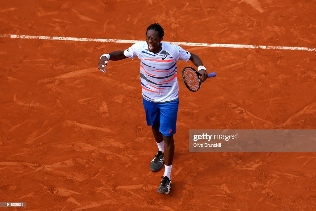 Gael Monfils of France celebrates a point during his men's singles match against Fabio Fognini of Italy on day seven of the French Open at Roland Garros on May 31, 2014 in Paris, France.