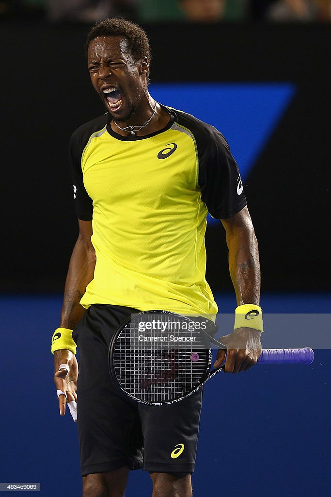 <a gi-track='captionPersonalityLinkClicked' href=/galleries/search?phrase=Gael+Monfils&family=editorial&specificpeople=213774 ng-click='$event.stopPropagation()'>Gael Monfils</a> of France celebrates a point during his third round match against Rafael Nadal of Spain during day six of the 2014 Australian Open at Melbourne Park on January 18, 2014 in Melbourne, Australia.