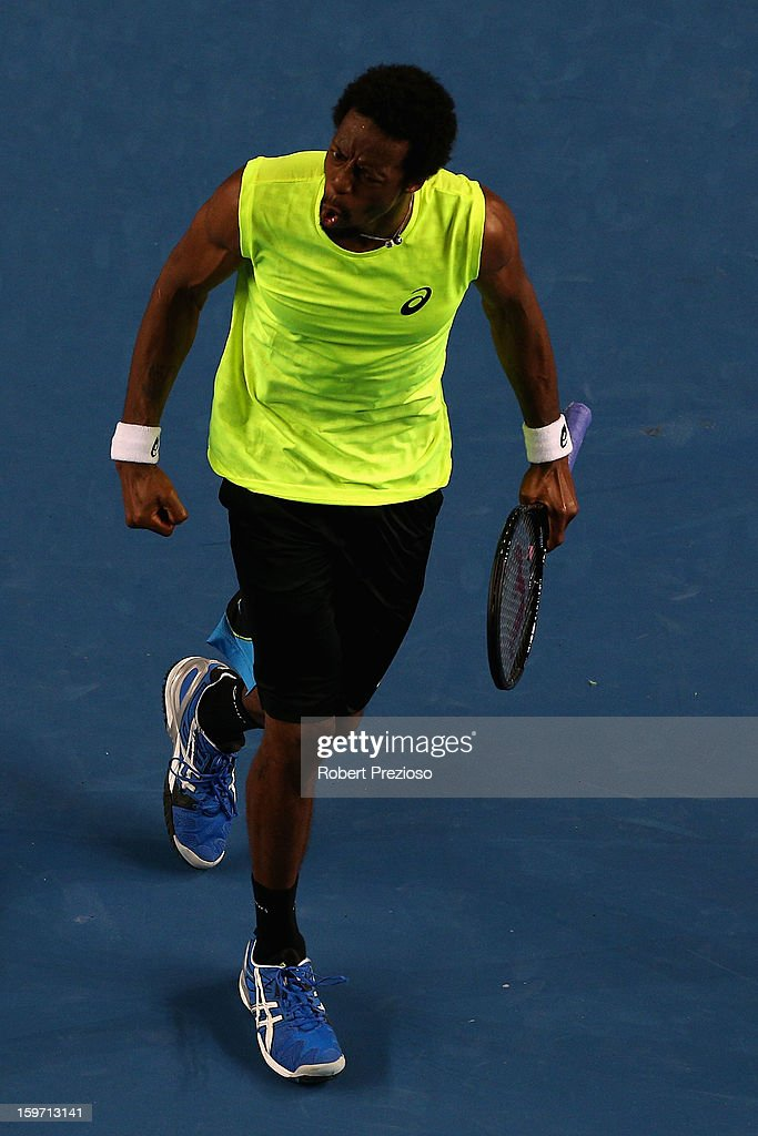 Gael Monfils of France celebrates a point in his third round match against Gilles Simon of France during day six of the 2013 Australian Open at Melbourne Park on January 19, 2013 in Melbourne, Australia.