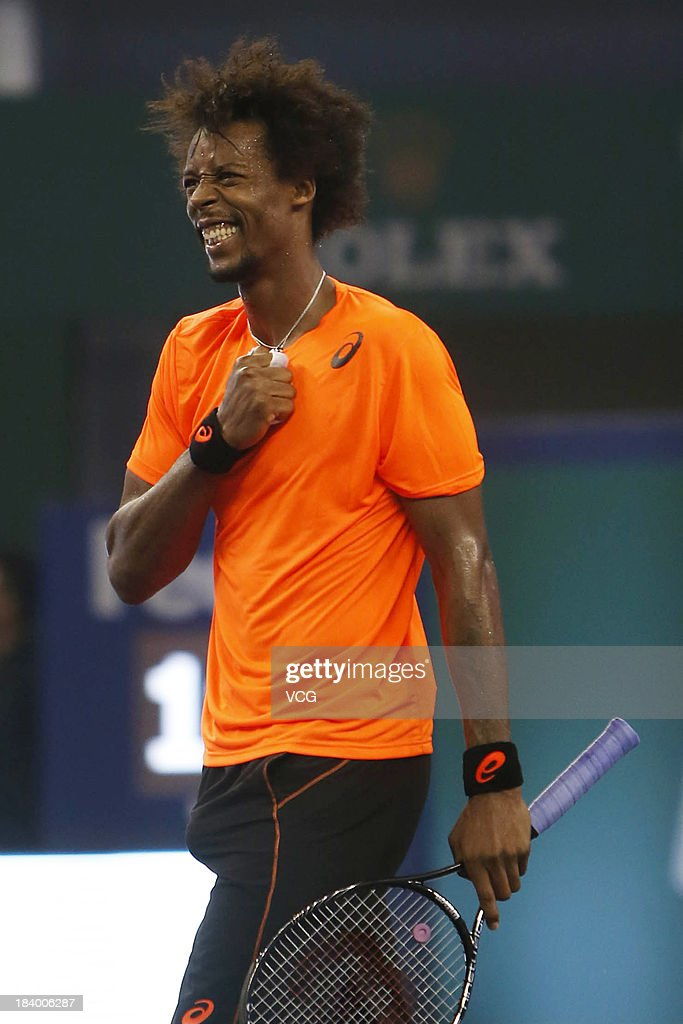 <a gi-track='captionPersonalityLinkClicked' href=/galleries/search?phrase=Gael+Monfils&family=editorial&specificpeople=213774 ng-click='$event.stopPropagation()'>Gael Monfils</a> of France celebrates after defeating Roger Federer of Switzerland on day four of the Shanghai Rolex Masters at the Qi Zhong Tennis Center on October 10, 2013 in Shanghai, China.