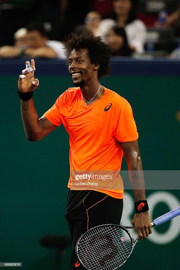 <a gi-track='captionPersonalityLinkClicked' href=/galleries/search?phrase=Gael+Monfils&family=editorial&specificpeople=213774 ng-click='$event.stopPropagation()'>Gael Monfils</a> of France celebrates his win against Roger Federer of Switzerland during day four of the Shanghai Rolex Masters at the Qi Zhong Tennis Center on October 10, 2013 in Shanghai, China.