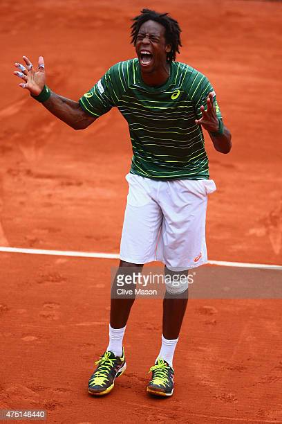 Gael Monfils of France celebrates match point in his Men's Singles match against Pablo Cuevas of Uruguay on day six of the 2015 French Open at Roland...